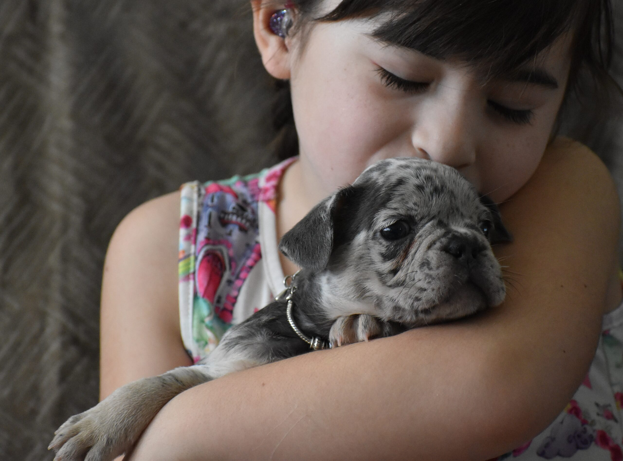 Child Kissing Puppy with Beaded collar